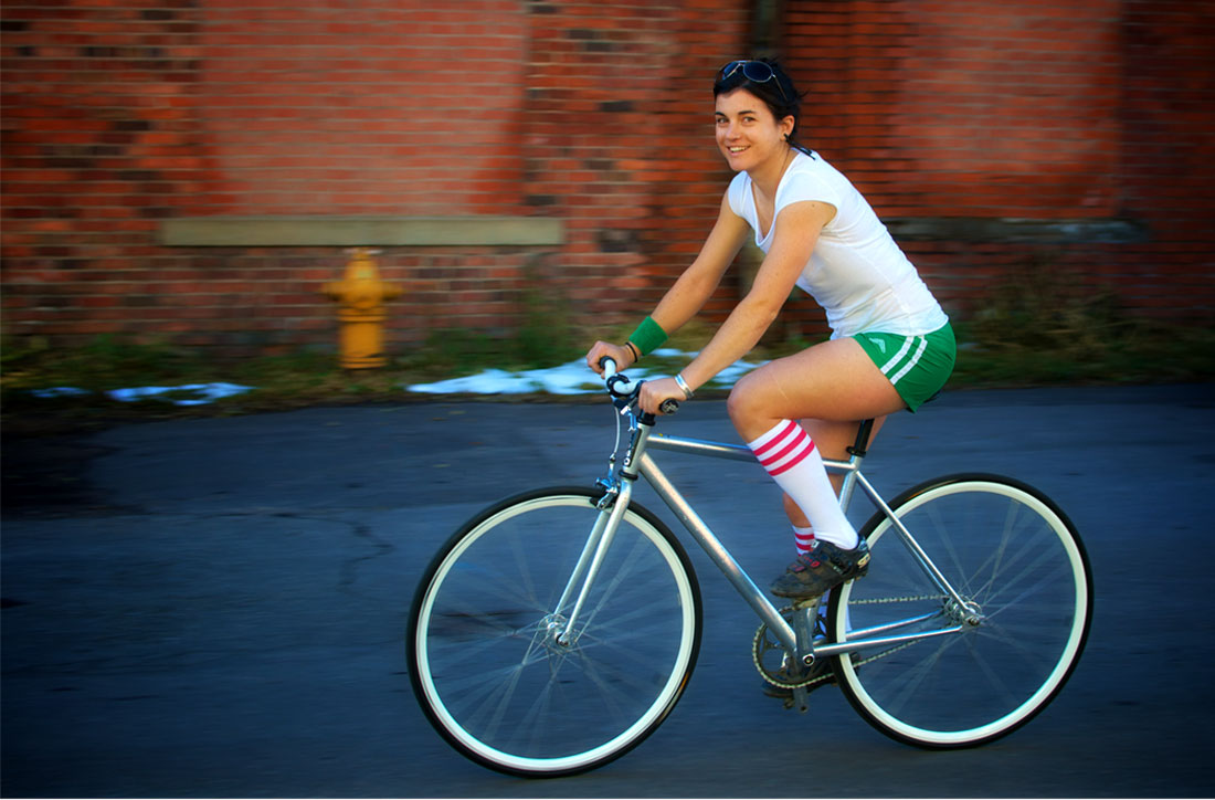 a young, athletic woman on a street bicycle